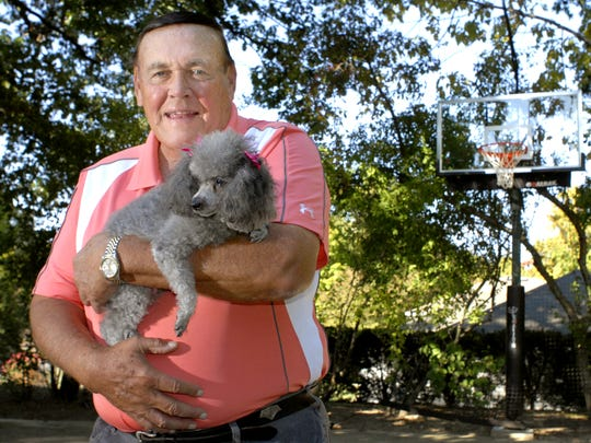 FILE – Gene Keady, lover of all living creatures, and his miniature poodle Queen.