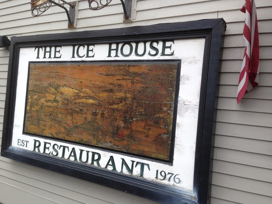 The Ice House restaurant is closing after 40 years on Battery Street. Its sign is weather-worn.