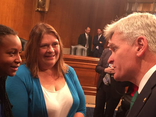 Sen. Bill Cassidy, R-La., (right) talks to April Hanrath of Salt Lake City and her daughter, Jocelyn, before a May 10, 2016 Senate hearing on dyslexia.