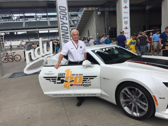 Roger Penske poses with the pace car he will drive at Sunday's Indianapolis 500. Penske has won a record 16 races as a team owner.