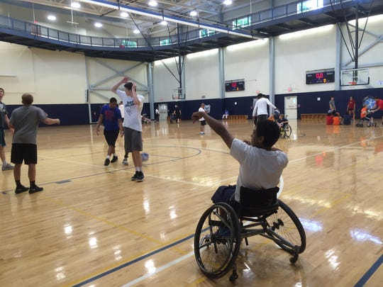 On Friday at Butler University's Health and Recreation Complex, members of the Bulldogs basketball team played basketball with 16 kids who have various disabilities.