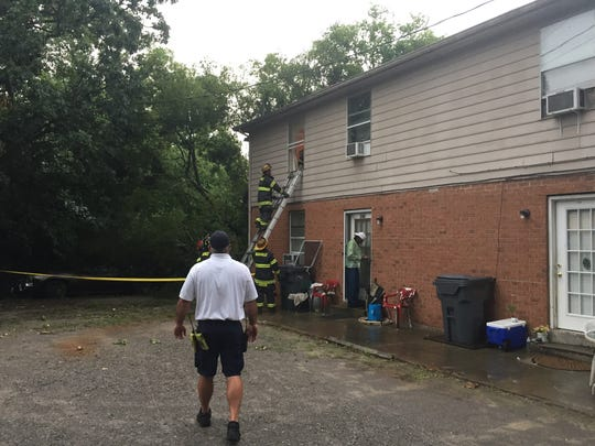Emergency crews respond to a family trapped in their home due to downed trees in Madison.