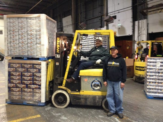 A Progresso forklift driver moves a load of soup meant for Community Food Bank of New Jersey.