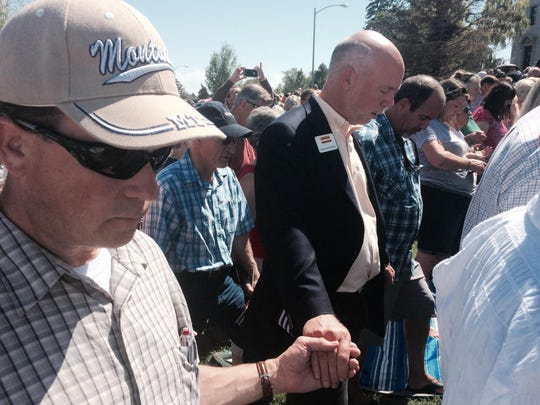 Republican gubernatorial candidate Greg Gianforte, right, joins in prayer at the Decision America Tour in Helena.