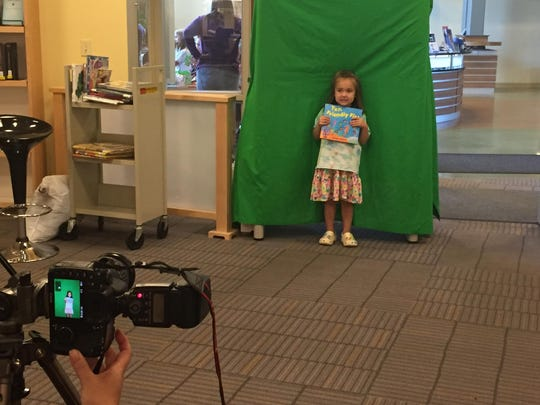 Addisyn Card poses in front of the green screen for