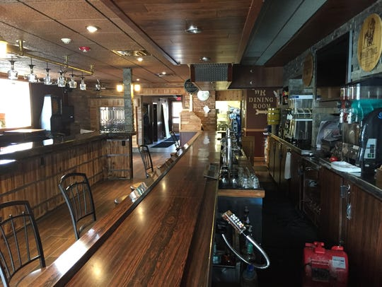 The bar side of Whiskey River Pub & Grill at 421 River