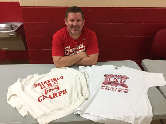 Rod Hubbard displays mementos of Fairfield's 1986 championship