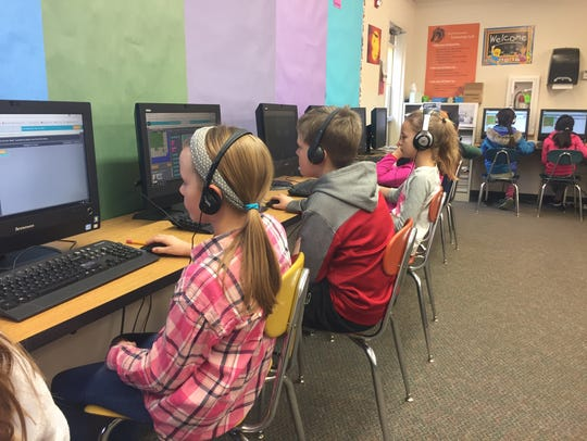Fourth grade students at Sunset Elementary work on