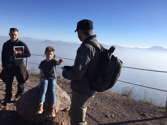 Henry Merrill, 5, on the rim of the crater of Mount