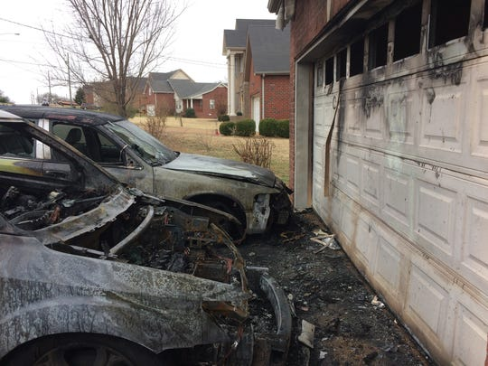 Homeowner William Lytton says that a security camera above his garage door captured an image of  someone pouring gasoline on two cars in his driveway before setting them on fire.