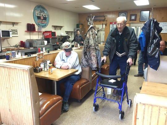 Clyde Prewett walks through the Home Cafe, pausing