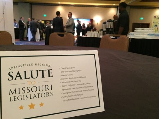 "A ""Salute to Missouri Legislators"" placard rests on a table as guests file into the Capitol Plaza Hotel on Wednesday, Jan. 25, 2017 in Jefferson City."