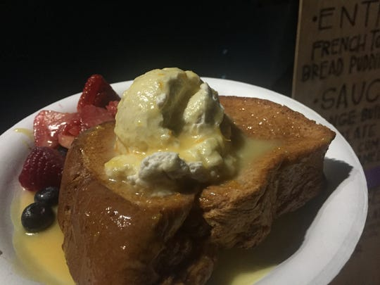 Orange butter sauce and thick whipped cream drenches