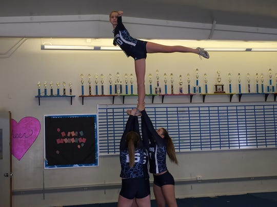 Players on Camarillo High's stunt team practice for Friday night's state championships.