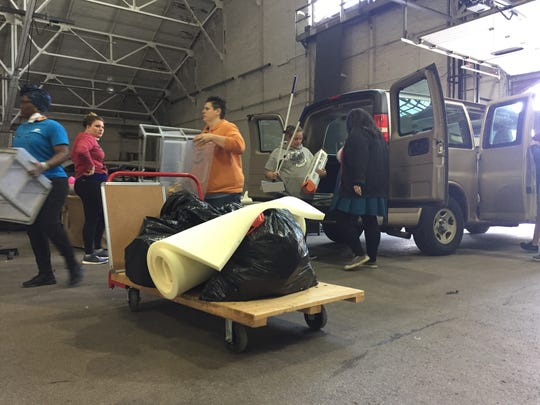 Volunteers unload a van from one of Purdue's residence halls Monday during Project Move Out.