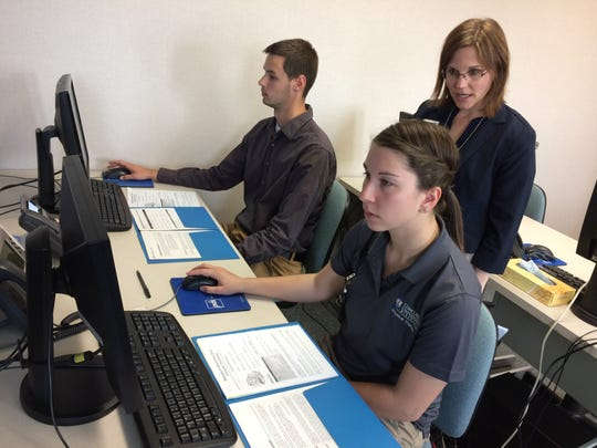 Marshfield Clinic Information Systems looks for workers with a wide variety of skills, including the ability to teach. Here instructor Maria Pernsteiner helps medical students Jared Bantin and Kelsey Paramore learn the Marshfield Clinic's software systems.