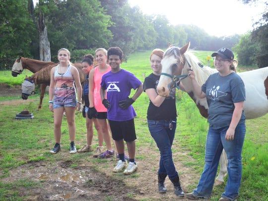 Young volunteers with Sumner Teen Center helped horses