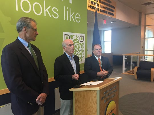 Rep. Peter Welch speaks at a press conference about privatizing air traffic control on Tuesday, flanked by Tom Torti on his right and Gene Richards on his left.