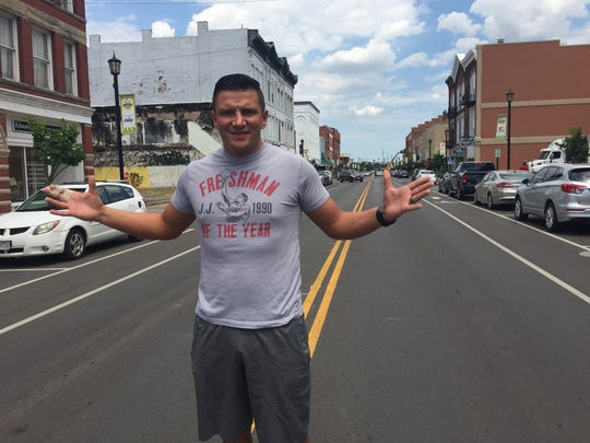 Live Pro Wrestling promoter and superstar Tim Horner Jr. stands in the middle of Front Street in Fremont, which will host the company's first outdoor event Saturday.