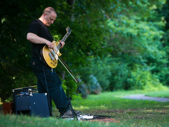 Artist and musician, Craig Colorusso does a sound check prior to his evening outdoor performance. The Delaware Art Museum hosts a 10-day exhibition which ends this Sunday in the Museum's Copeland Sculpture Garden, Craig Colorusso: Sound + Light features the artist's Sun Boxes with special presentations of his CUBEMUSIC in the Labyrinth in the Anthony N. Fusco Reservoir.
