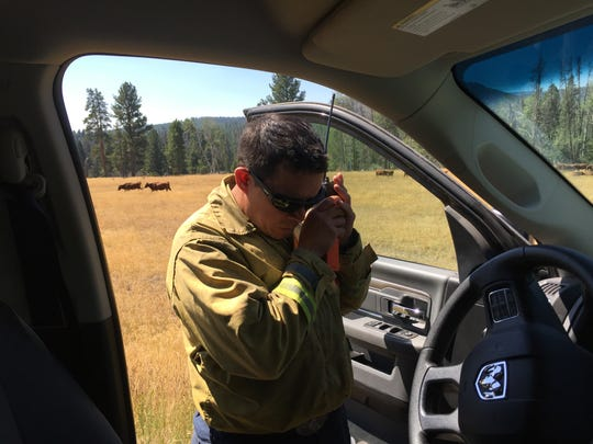 "Jess Montijo talks on the radio as he heads toward the Arrastra creek fire Wednesday. ""It wasn't doing this yesterday,"" he said when he saw the large smoke plume."