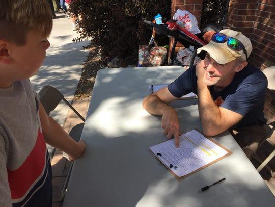 Mike Salowitz, right, interviews Jensen Stiers of Fenton