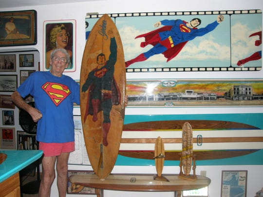 Bud Gardner with his Superman surfboard that was stolen 36 years ago and recently returned.