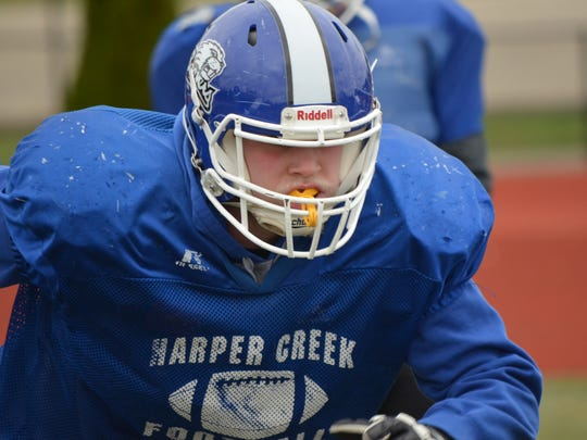 Harper Creek's Ryan McCafferty plays offensive and defensive line for the Beavers, who are undefeated on the season and set to play Stevensville-Lakeshore in the second round of the playoffs.