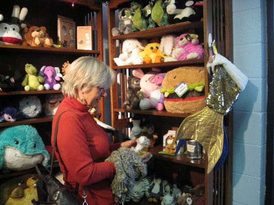 Eileen White of Redding shops in the plush toy section at Sugarplum Kids Old-fashioned Toys, Candy and Children's Boutique.