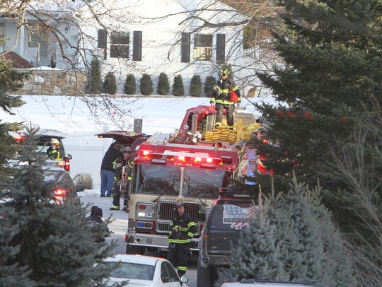 Firefighters on the scene of a fire at the home of