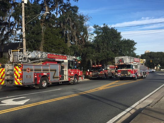 Tallahassee Fire Department crews work to extinguish a fire Friday morning at 1518 S. Adams St.