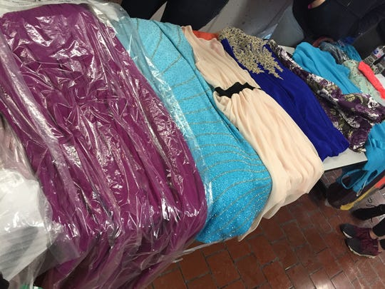 Members of Sisters for Sisters are collecting used prom dresses to give away at an event at Ever after Binghamton Bridal.