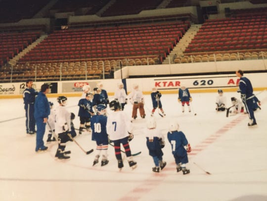 Broc Little, second from right, age age 4 learning to play hockey at a Phoenix Roadrunners school at Veterans Memorial Coliseum.