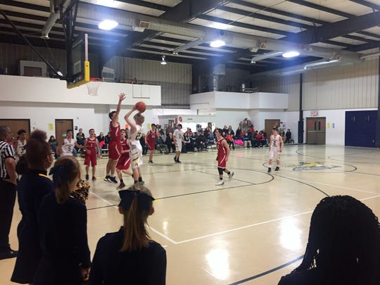 Marshall Academy has a student enrollment of 55, with 15 of the school's 25 boys playing in the basketball program.