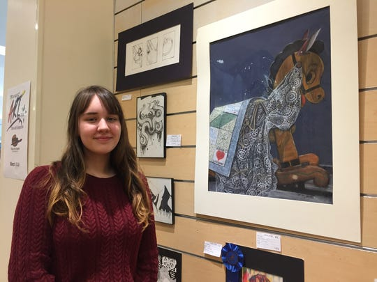 "Owego Free Academy senior Larissa Hankey with ""Daisy,"" a pencil and charcoal submission in the Fine Arts Society of the Southern Tier's Young at Art Show and Competition."