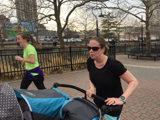 Heather Waterson runs with Janine Lewandoski alongside