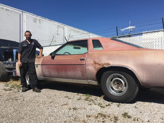Billy Williams of Reno poses next to his Chevy Malibu in August 2018.