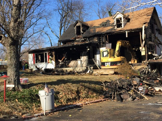 The charred remains of the home of Ron and Ruth Evers