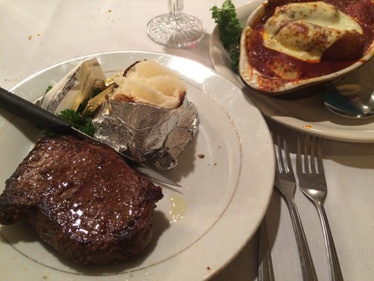 An 8-ounce steak and a dish of ravioli at Riccelli's.