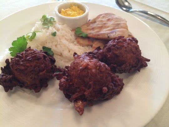 The seasonal vegetarian entree was sweet potato, carrot and onion fritters with naan and yogurt salsa.