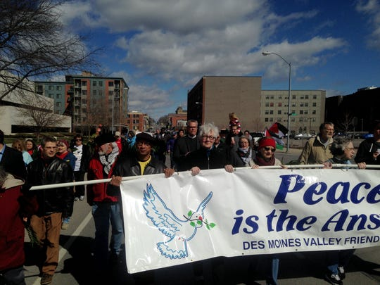 Des Moines-area church members took to the streets of Des Moines to celebrate Palm Sunday and spread a message of peace. The Palm Sunday procession is a yearly event that is hosted by the Des Moines Area Ecumenical Committee for Peace.