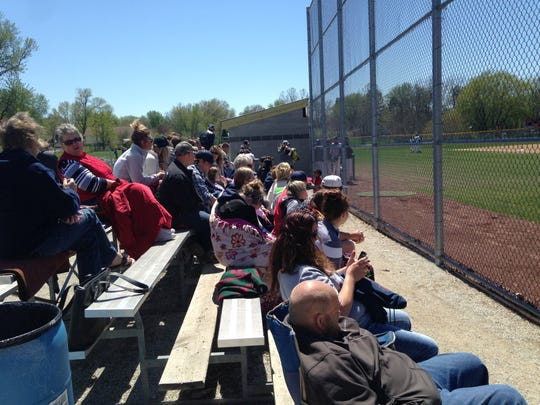 Family, students and staff cheer on the AIB baseball