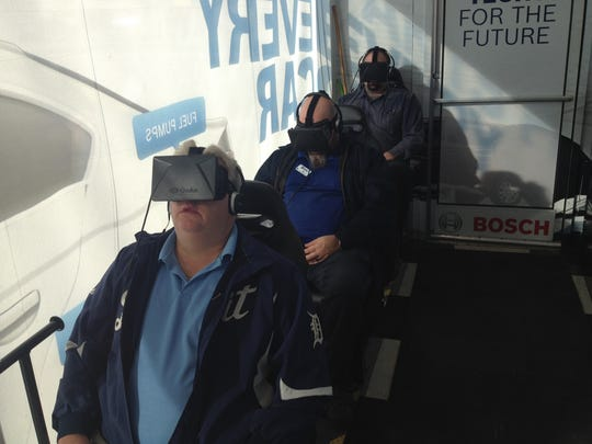 Auto service technicians at the NAPA auto parts store in Shelby Township try out a virtual reality tool to help them understand repair of engines and other technologies under the hood.