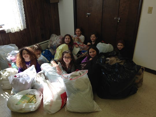 A Big Flats Brownie troop collected blankets and towels for animals at the Chemung County Humane Society and SPCA. Pictured, from left, are Keira Miller, Sarah McConnell, Sophia Lorenz, Jasmine Marks, Alexis Lambert, Olivia Heppinger, Ava Rumsey and Zophia Lunduski.