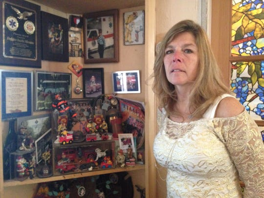 DiBenedetto in her home, next to her collection of