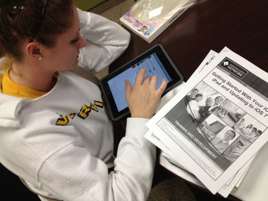 A veterinary tech student at Globe University-Wausau uses the school's Academic Skills Center to get her iPad ready for classes.