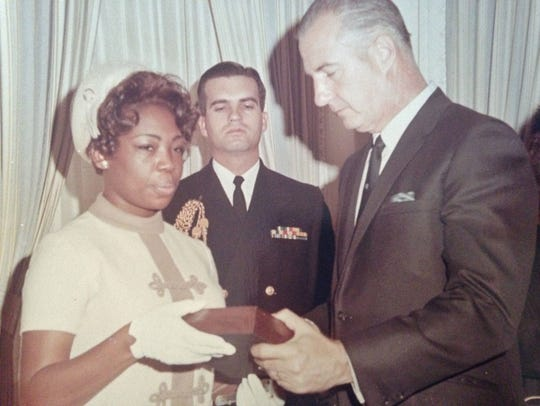 Mary Sims receiving husband Clifford's posthumous Medal