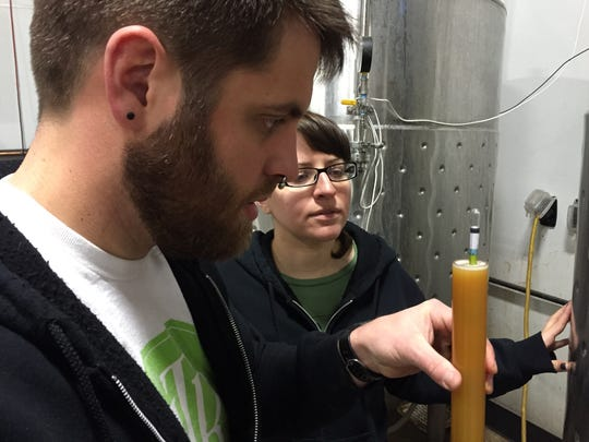 Scott Emond and Jesse Kleinedler test a brew at Under the Rose Brewing Co. at its original location on East Fourth Street. The brewery opened a brewpub in spring 2018 in Midtown Reno.