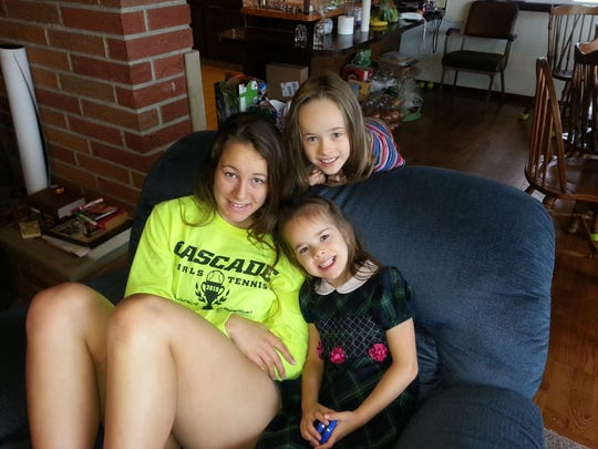 Esther Suelzle, a Cascade High School graduate and Corban University student, is shown with her sisters at the family home in Aumsville. Suelzle died of cancer last year.