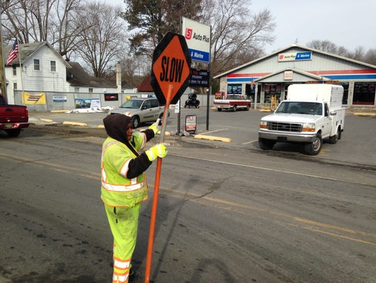 Sherri Witherspoon, a flagger with Site Works, halts